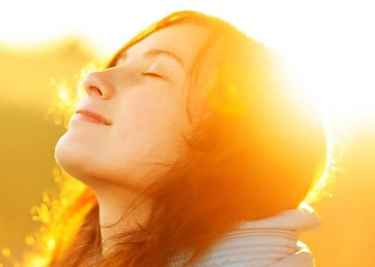 anxiety free young woman sunlight